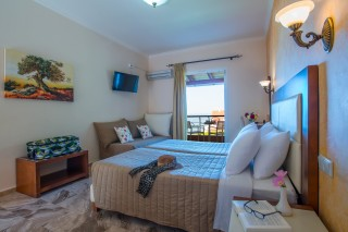 Cheap Corfu rooms with sea view Philoxenia hotel Triple Room with unique sea view and cozy bed