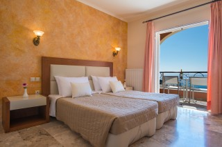 Cheap Corfu rooms with sea view Philoxenia hotel big bedroom with cozy bed and unique view of the Ionian Sea