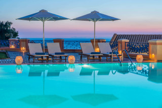 Corfu hotel by the sea in Ermones Philoxenia offers a big swimming pool with an amazing view of the Ionian Sea