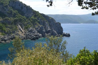 Corfu sightseeing Philoxenia hotel Ionian Sea is surrounded by cliffs and vegetation