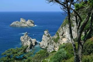 Corfu sightseeing Philoxenia hotel landscape of the Ionian Sea consists of green vegetation and cliffs