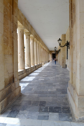 Corfu sightseeing Philoxenia hotel the corridor of a neoclassical building that is found in Corfu