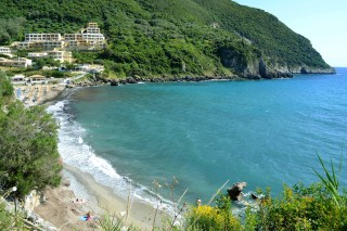 Ermones Corfu Philoxenia hotel Ermones is a large beach surrounded by green trees and rocks
