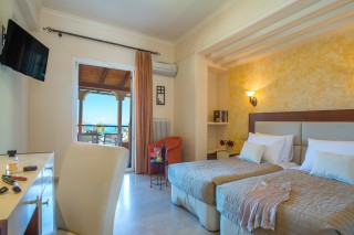 Gallery Corfu Hotel Philoxenia Bedroom has a cozy bed, unique sea view, flat TV and much more