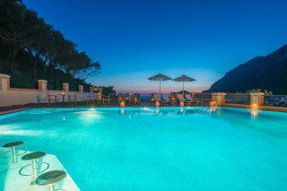 Gallery Corfu Hotel Philoxenia Pool by night offers a unique sea and mountain view