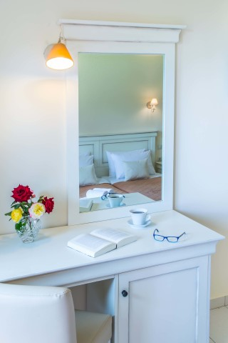 Gallery Corfu Hotel Philoxenia Room Amenities include a cozy bed, mirror and dressing table