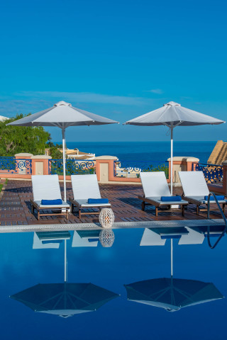 Gallery Corfu Hotel Philoxenia Swimming Pool Sunbeds and umbrellas with view of the Ionian Sea