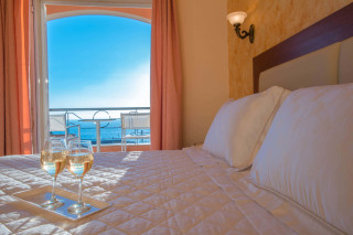 Ideal seaside Corfu accommodation Philoxenia hotel double bedroom with view of the Ionian Sea