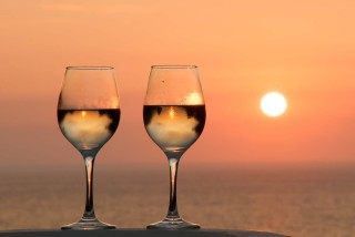 Modern facilities Philoxenia hotel enjoy a glass of Greek Wine in the sunset