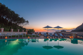 Modern facilities Philoxenia hotel swimming pool view during the sunset