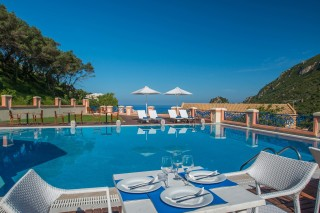 Modern facilities Philoxenia hotel Pool bar restaurant tables next to the swimming pool with sea view