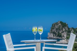 ideal seaside corfu accommodation philoxenia hotel enjoy a drink in your room's balcony and admire the lovely view of the Ionian Sea