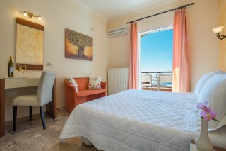 ideal seaside corfu accommodation philoxenia hotel big bedroom with double bed and an amazing view of the Ionian Sea