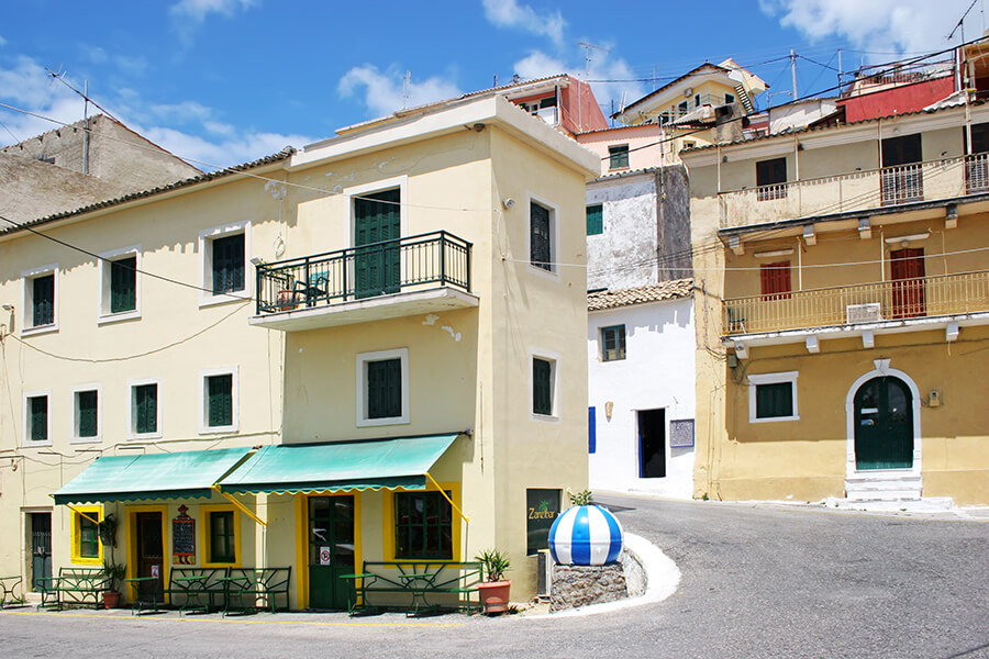 ermones corfu philoxenia hotel pelekas village has various small houses and shops in Corfu